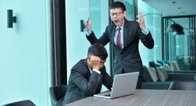 Asian Business people having trouble working, blaming at office
